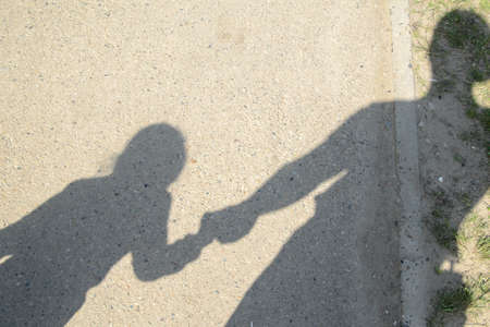 unrecognizable person: the shadow of an adult and a child
