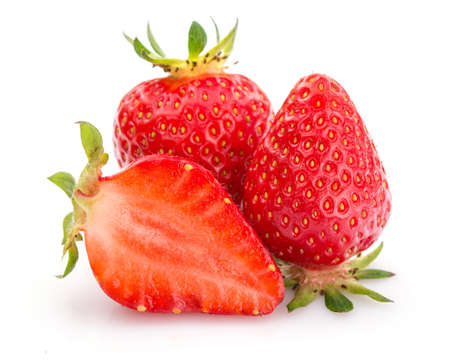two and a half: Two whole strawberries and one half Stock Photo