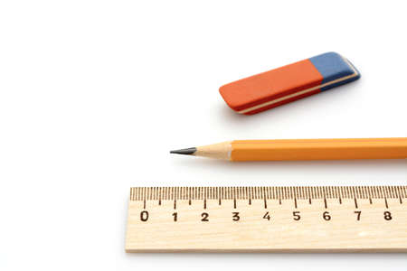 no way out: wooden ruler a simple pencil and eraser on a white background