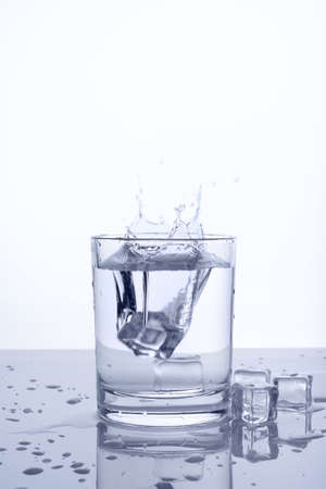 falling cubes: falling ice cubes in a glass of water Stock Photo
