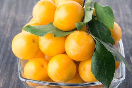 alycha: cherry plum lying in a vase Stock Photo