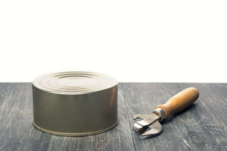 can opener: tin and a can opener Stock Photo