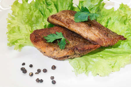 grilled meat on lettuce leaf Stock Photo