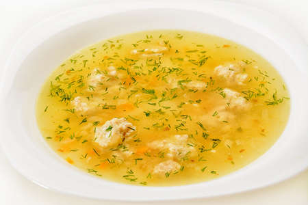 Soup with meatballs on a plate