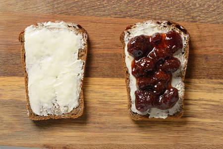 bread smeared with butter and jam