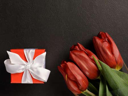 box bow tulips on black background