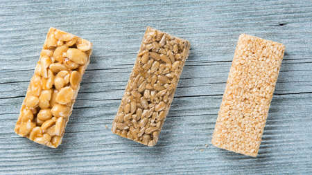 seeds of sunflower, nuts and sesame in caramel in the form of bars