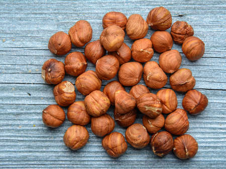 peeled hazelnuts  lie on a wooden surface