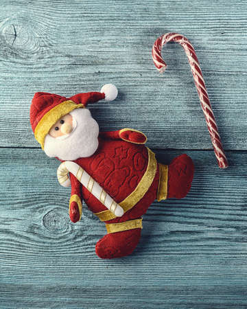 toy in the form of Santa Claus and Lollipop