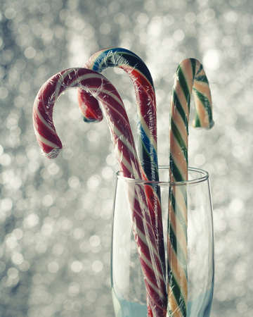 Christmas candy canes of different colors on a beautiful background Archivio Fotografico
