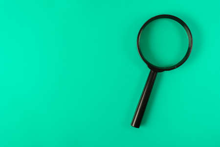 magnifying glass on a green leaf