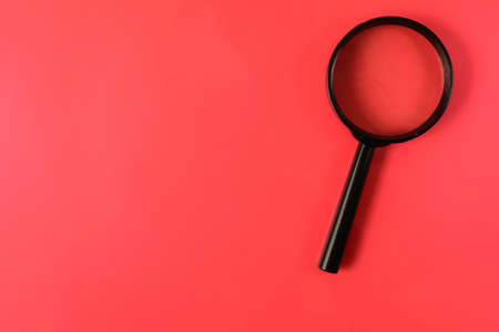 magnifying glass on a red sheet