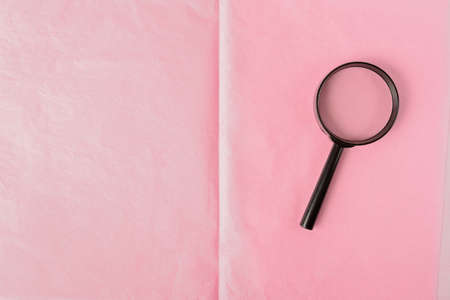magnifying glass on a pink leaf