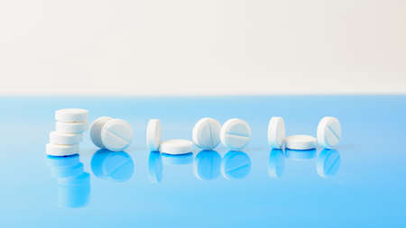 the tablets are on a blue surface