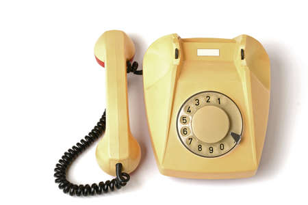disk phone in yellow on white