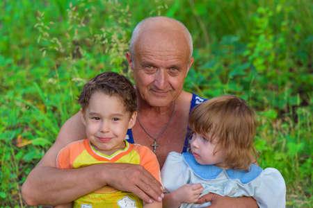 dacha: Grandfather with grandchildren prerode Stock Photo