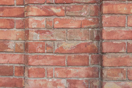 Old red brick wall texture background. Close view