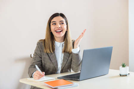 Young woman using laptop, hr manager working at home composing e-mail job offer to new open vacancy candidate, typing answer letter after resume consideration Stock Photo
