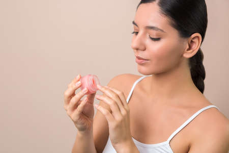 skin care and protection. woman applying cream. spring dehydration