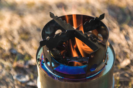 close up view of fire flame in portable wood burner