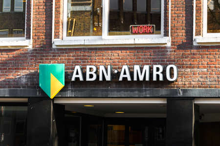 Utrecht, Netherlands, January 24 2021: ABN Amro bank closeup inscription on a building and the word work red-lighted above it
