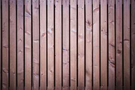 vertical brown wooden slats background with dark vignette corners for creative designs Foto de archivo