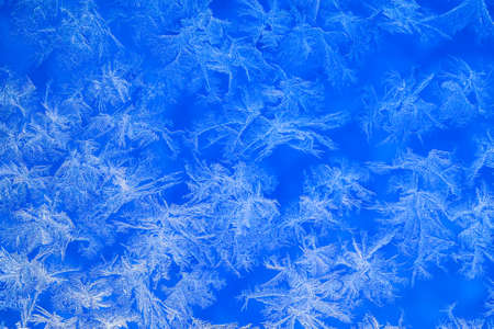 frosty pattern on glass. ice pattern on window closeup