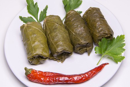 Grape leaves rolls. Sarmale, dolma, sarma, golubtsy or golabki. Grape leaves stuffed with meat, rice and vegetables. East European and Asian traditional cuisine. Fresh sarmale or dolmades, Romanian, Greek, Turkish, Polonia, Iran and Moldavian typical food.