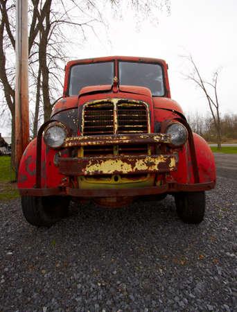 Old rusted car on the farmland. Stock Photo - 9817539
