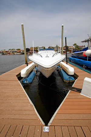 A view of the private yachts bow, docked in the marina. photo