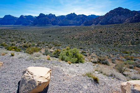 View of dry landscape and rock formations of the Mojave Desert.