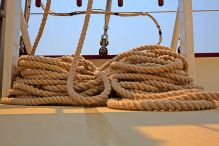Coiled rope rigging on a sailboat deck. photo