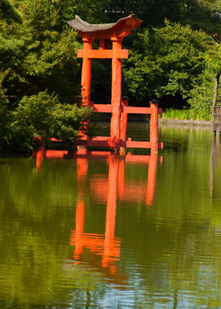 Japanese Garden and pond with a red Zen Tower. photo