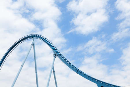 Steel loops of the extreme rollercoaster ride in the amusement park.