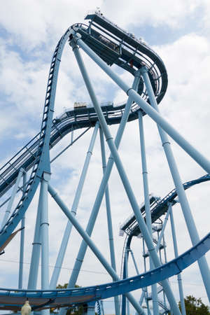 looping: Steel loops of the extreme rollercoaster ride in the amusement park.