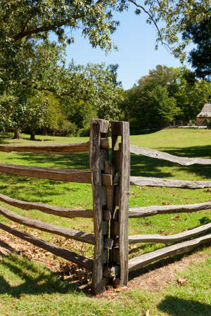 View of the ancient wooden fence on the farm. photo
