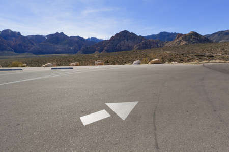 Directional arrow on the empty parking lot in Mojave Desert, Nevada. Stock Photo