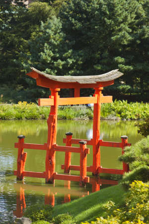 Japanese Garden and pond with a red Zen Tower  photo