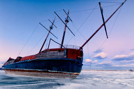 ship wreck: Winter landscape with a shipwreck.
