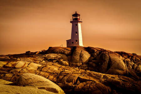 shore: Lighthouse on a rocky shore