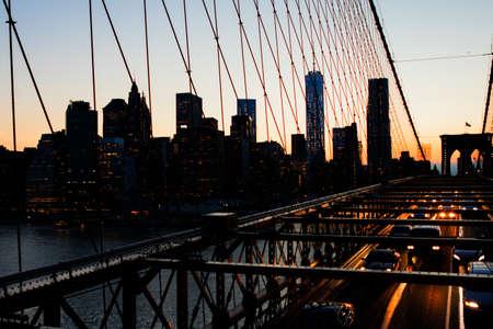 Bright lights of New York City at sunset.