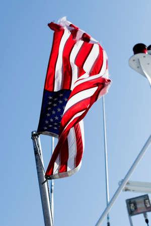 flag pole: Weathered American flag on a flag pole. Stock Photo