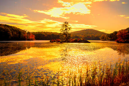 water fall: Fall landscape with the forest lake at sunset. Stock Photo