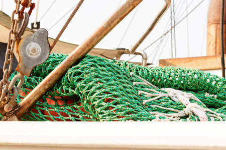 commercial fishing net: Detail of commercial fishing boat equipment at the dock. Stock Photo