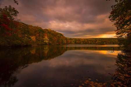 fall landscape: Fall landscape with the forest lake at sunset. Stock Photo