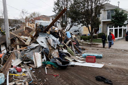 devastation: STATEN ISLAND, USA - NOVEMBER 4: The images of devastation caused by the Hurricane Sandy  and rescue services response November 4, 2012 on the streets of Staten Island, USA. Editorial