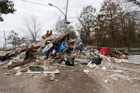 staten: STATEN ISLAND, USA - NOVEMBER 4: The images of devastation caused by the Hurricane Sandy  and rescue services response November 4, 2012 on the streets of Staten Island, USA. Editorial