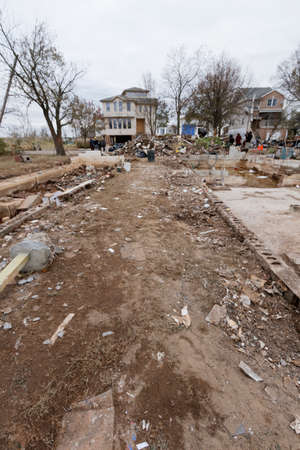 fema: STATEN ISLAND, USA - NOVEMBER 4: The images of devastation caused by the Hurricane Sandy  and rescue services response November 4, 2012 on the streets of Staten Island, USA. Editorial