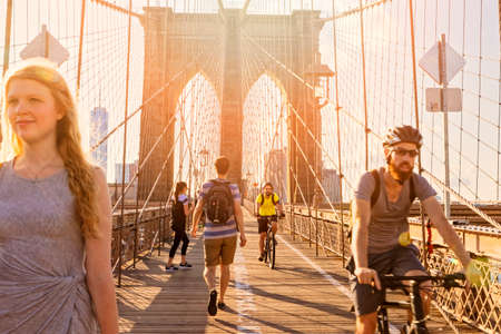 bicyclists: NEW YORK CITY, USA - JUNE 29, 2015: Pedestrians and bicyclists on the Brooklyn Bridge on a sunny day, June 29, 2015. Editorial
