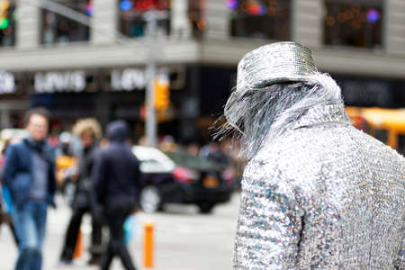 regulated: New York City, USA - March 18, 2015: Costumed street character performers on the streets of New York City on March 18, 2015. Costumed characters who pose for pictures with tourists in Times Square could become regulated under a proposed New York City law.